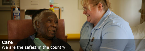 Nurse smiling with elderly person