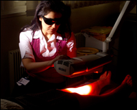 Consultant performing Photodynamic Therapy on a patient